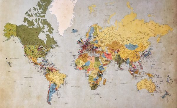 An old and colorful map of the world.