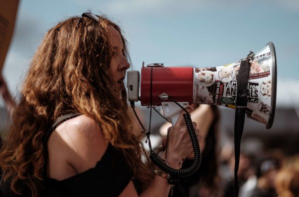 Woman talking into bullhorn
