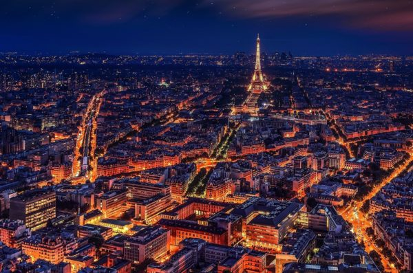 Eiffel tower and Paris city scape at night with lights.
