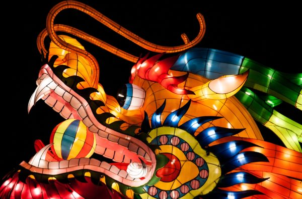 Chinese dragon float or balloon with bright lights.