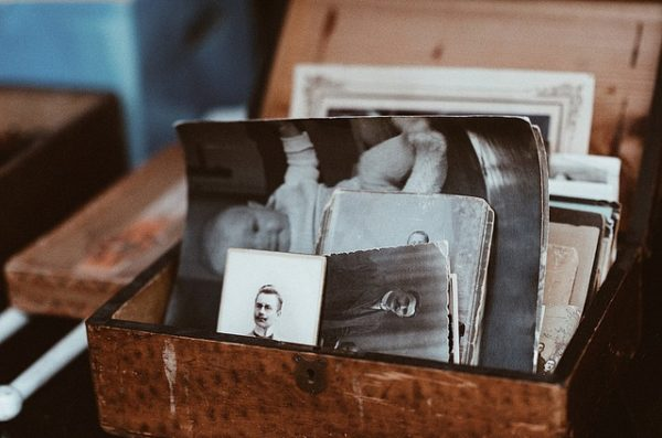 A leather box holding antique family photographs.