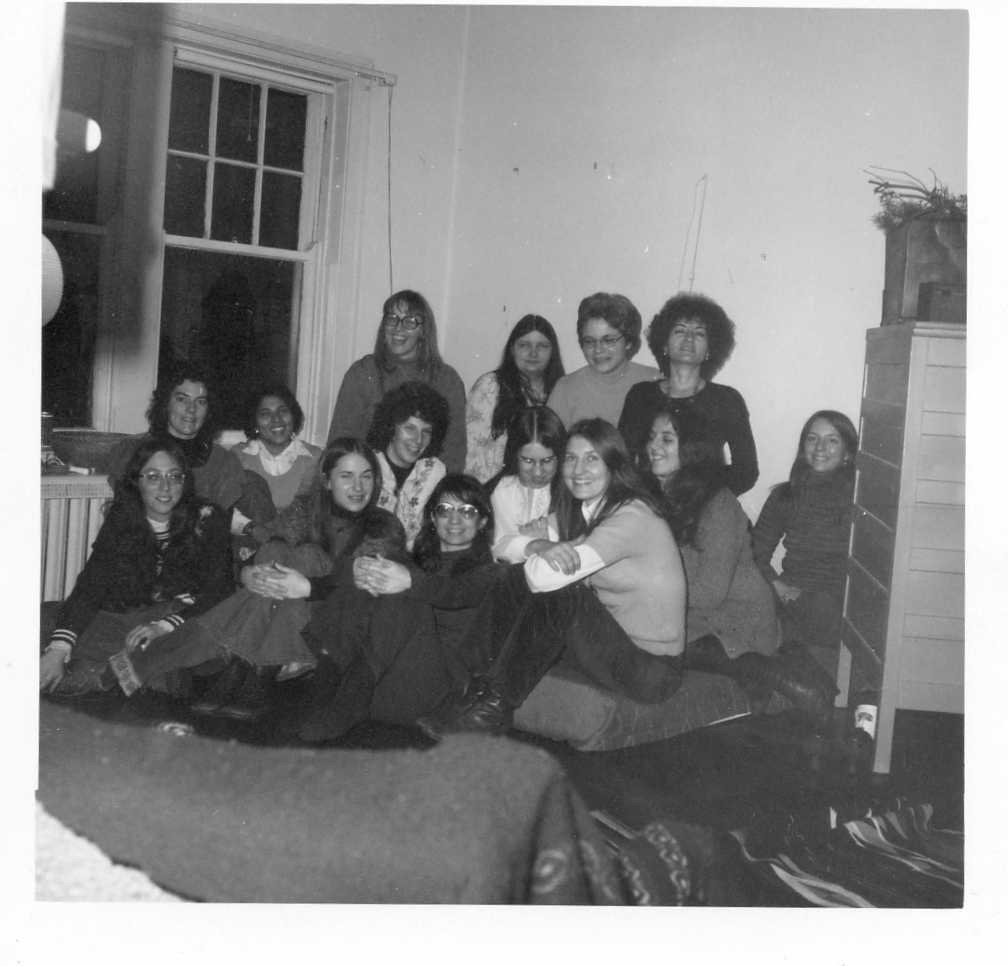 Image of the Women's Teaching Collective 1974 members seated in a group.