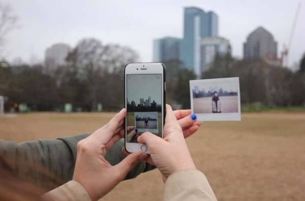 social media on a phone in front of a city background