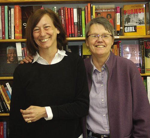 Linda Bubon and Ann Christopherson stand in front of a bookcase